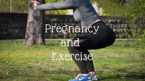 A pregnant lady exercising